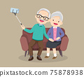 old couple take selfie on smartphone on sofa 75878938