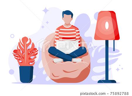 Freelancer boy in bean bag works at home. 75892788
