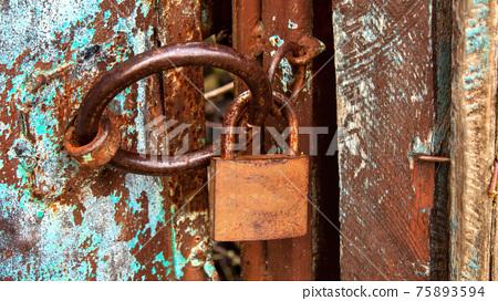 Rusty lock on an old door in Moldova 75893594