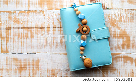 Handmade wooden decoration on the wallet 75893681