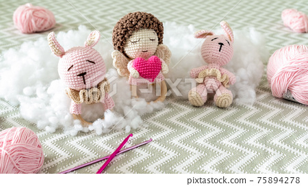 Cute knitted plush toys on the sofa 75894278
