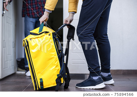 Delivery man with yellow backpack and client 75894566