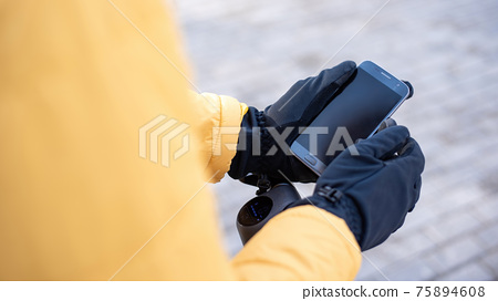 Food delivery man using smartphone 75894608