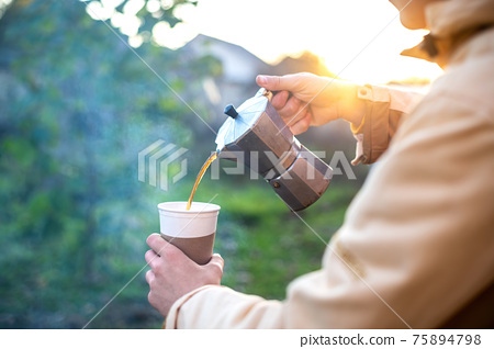 A man making coffee on nature 75894798