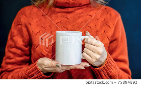 Woman holding a white cup 75894893