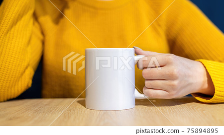 Woman holding a cup 75894895