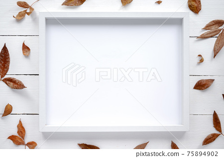 Table with a photo frame and decoration 75894902
