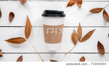 Table with cup of coffee and decoration 75894904
