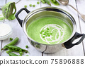 Saucepan with mashed pea soup 75896888