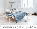 White loft interior in classic scandinavian style. Hanging bed suspended from the ceiling. Cozy large folded gray plaid, giant knit blanket, super chunky yarn, arm knitting. Trendy room design. 75904237