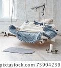White loft interior in classic scandinavian style. Hanging bed suspended from the ceiling. Cozy large folded gray plaid, giant knit blanket, super chunky yarn, arm knitting. Trendy room design. 75904239