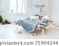 White loft interior in classic scandinavian style. Hanging bed suspended from the ceiling. Cozy large folded gray plaid, giant knit blanket, super chunky yarn, arm knitting. Trendy room design. 75904244