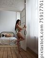 Sexy woman in lingerie standing near window 75917761