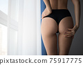 Crop woman with perfect buttocks 75917775