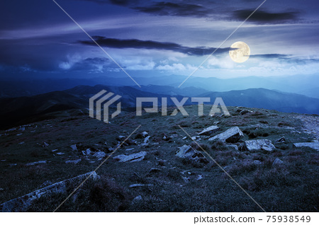 carpathian summer mountain landscape at night. beautiful countryside with rocks on the grassy hill in full moon light clouds on the blue sky. wonderful travel destination 75938549