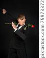 Young ballroom dancer dancing 75973372