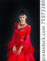 Woman ballroom dancer in red dress on dark background 75973380