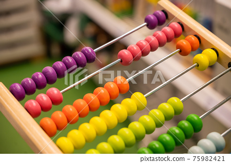 Bright colored hand abacus. Children's wooden toy for the study of arithmetic. 75982421