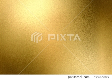 Light shining on gold painted metallic wall with copy space, abstract texture background 75982805