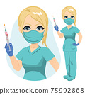 Young beautiful nurse in green uniform holding Covid-19 vaccine and wearing medical mask 75992868