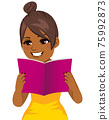 Young woman happy smiling focused reading holding book with both hands 75992873