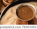 Turkish coffee prepared in sand with turk 76003065