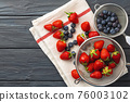 Fresh ripe strawberry and blueberry in bowl 76003102