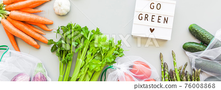 Fresh vegetables in reusable produce shopping bags 76008868