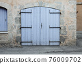 Closed large blue door in an old house in the Provence, France 76009702