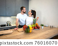 Couple Together In The Kitchen With Fruit And Vegetables 76016070
