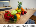 Fruits And Vegetables On The Table Of Modern Kitchen 76016084