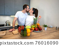 Couple Together In The Kitchen With Fruit And Vegetables 76016090