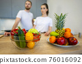 Couple Together In The Kitchen With Fruit And Vegetables 76016092