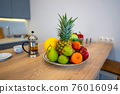 Fruits And Vegetables On The Table Of Modern Kitchen 76016094