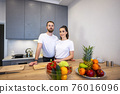 Couple Together In The Kitchen With Fruit And Vegetables 76016096