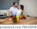 Couple Together In The Kitchen With Fruit And Vegetables 76016098