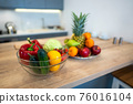 Fruits And Vegetables On The Table Of Modern Kitchen 76016104