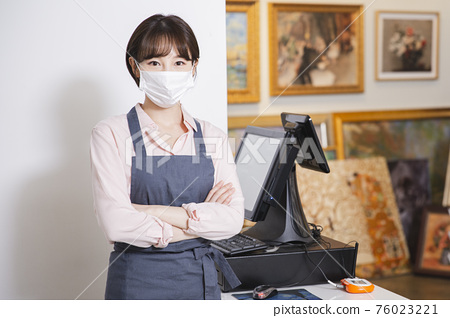 Portrait of staff working at store checkout 018 76023221