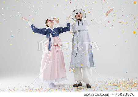 Male and female in Korean traditional clothes Hanbok. comic humorous concept. 069 76023970