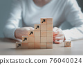 Wooden block stacking as step stair growth success process on wooden table background, Business organization startup concept. 76040024