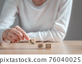 Woman holding wooden blocks with icon telephone, mail and email, Contact us, Connection,  Online business communications concept. 76040025