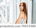 Pretty confident woman portrait with copy space 76053486