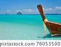 Wooden boat at tropical paradise beach with copy space 76053500