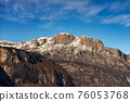Snow Capped Mountain Range of the Paganella in Winter - Alps Trentino Italy 76053768