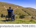 optimistic handicapped man sitting on wheelchair 76061001