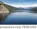 Cruising ship on the storage lake Vidraru, Arges county, Romania 76061002