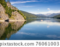Cruising ship on the storage lake Vidraru, Arges county, Romania 76061003
