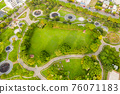 green and funny park at a city 76071183