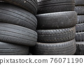 old used car tires stacked in piles 76071190