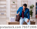 Young male employee in oversleeping concept 76071906